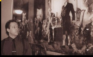 Cody Robert Judy, stands before image of signing of the Declaration of Independence
